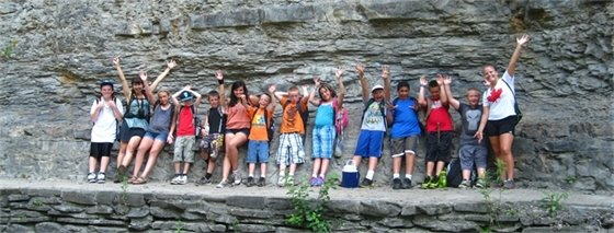 Picture of kids on a rock ledge at summer camp