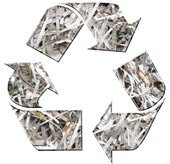 picture of paper shredding in the recycling logo