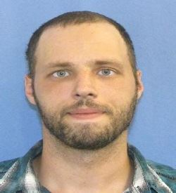 This is a picture of John Kucienski who has several outstanding warrants for his arrest