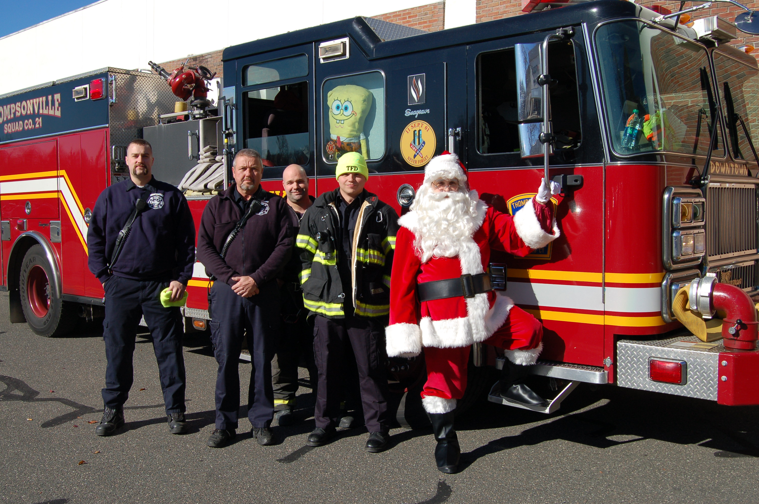 Firefighters with Santa