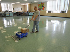 Waxing the floors at Enfield High School