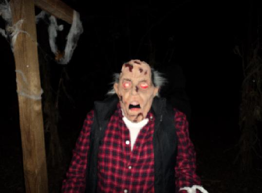 Skin on an old man with glowing red eyes appears to be falling apart