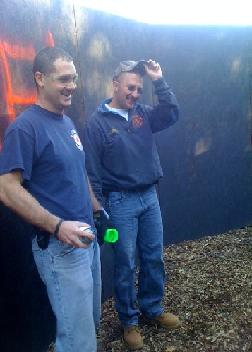 Firefighters smile excitedly as they finish preparing the haunted trail