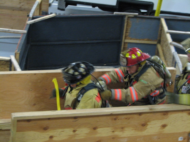 One firefighter leads others through The Maze