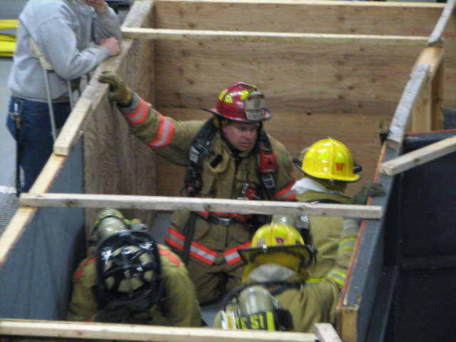 Firefighters work together to get through The Maze