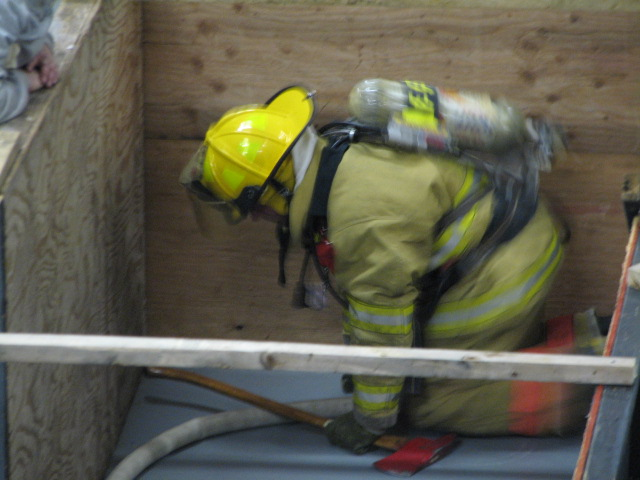 An exhausted firefighter works up the will to continue through The Maze