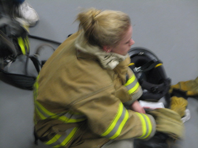 A firefighter takes a breather during The Maze drill
