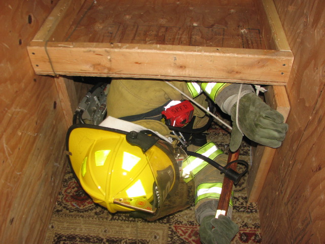 The narrow crawl spaces require firefighters to keep their cool in tight spaces while wearing heavy gear