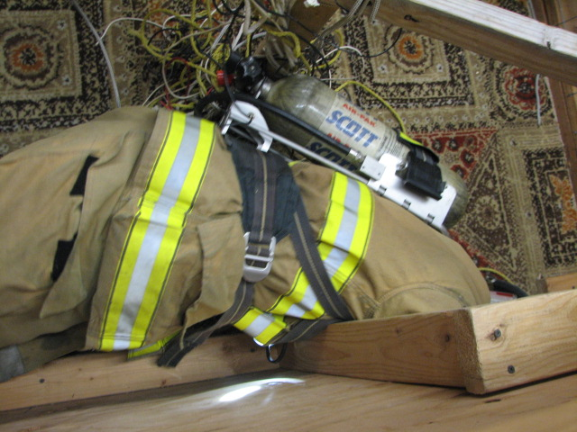 Firefighters have to work their bodies around tight corners to prevent problems with their gear