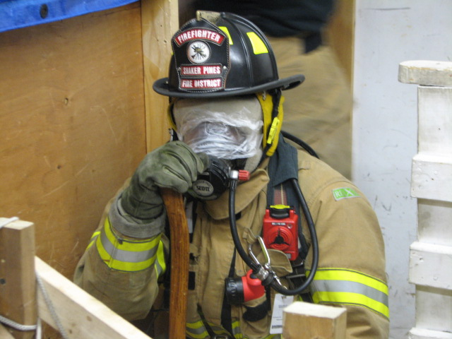 A firefighter adjusts the gear before going deeper into The Maze