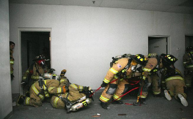 Firefighters practice rescuing fire victims