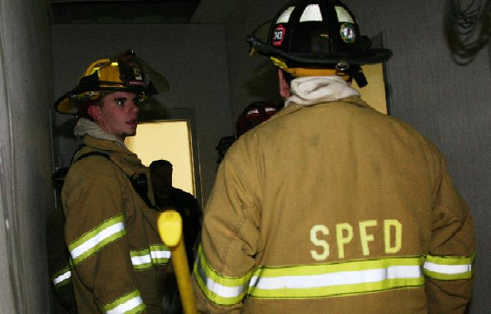 Firefighters discuss the necessary action for completing the drill