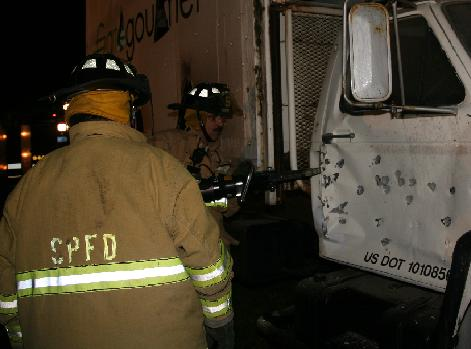 Firefighters use a tool to force the passenger door open