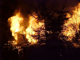 Flames engulf the home at night
