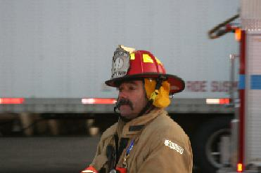 A firefighter catches his breath after getting the fire out