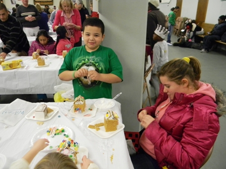 Children build ginger bread houses