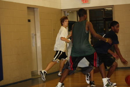 A player tries to keep the other team from scoring points