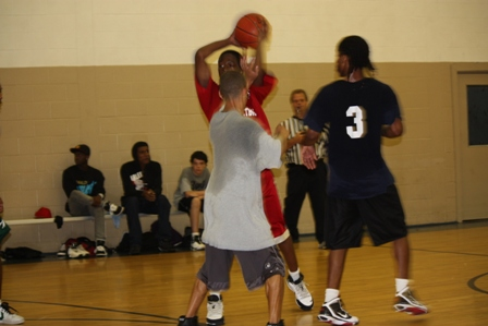 A player tries to get the ball to a team member over the other team