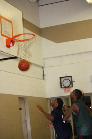The ball swooshes through the net after passing through the hoop