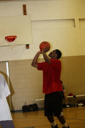 A player takes a jump shot to score some points for his team