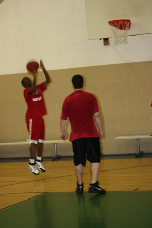 A player jumps up for a 3 point shot