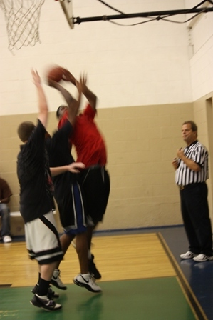 A player shoots the ball up to the hoop