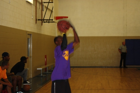 A player takes a jump shot
