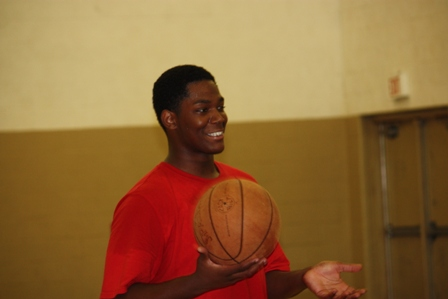A player smiles as he gets the ball