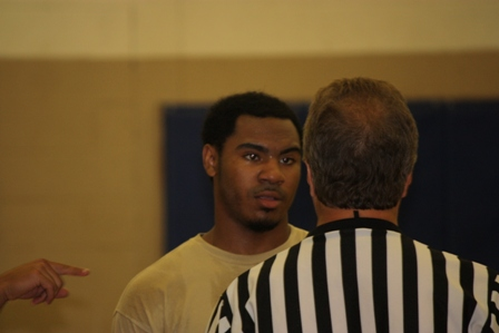 The referee speaks with a player