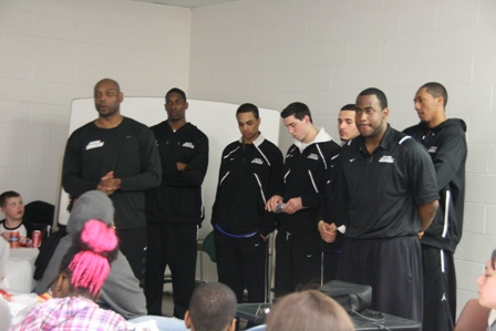 Players for CCSU speak to a group of kids