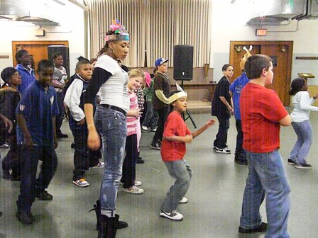 The children start dancing as a group