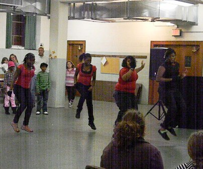 The dancing group performs an energetic dance