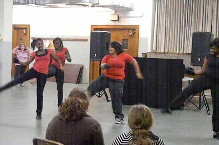 A group of 4 young ladies dance for the attendees