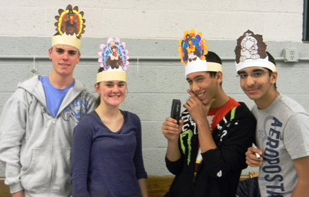 Participants make and wear festive hats
