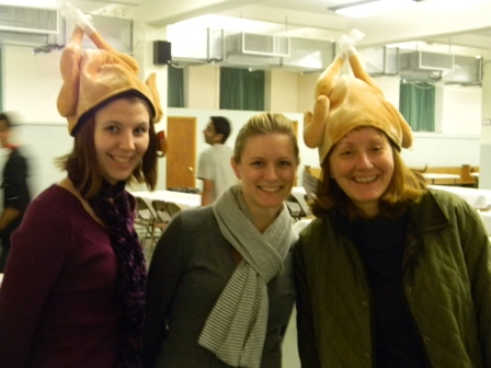 Volunteers wear festive turkey hats