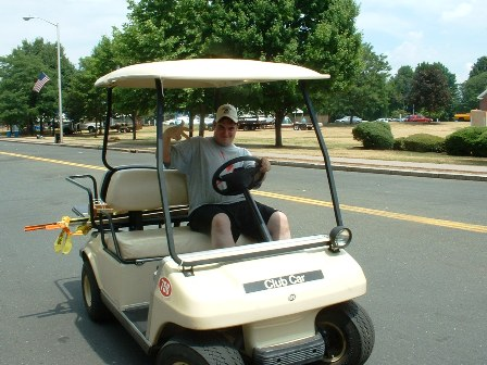 A club member drives supplies around in a golf cart