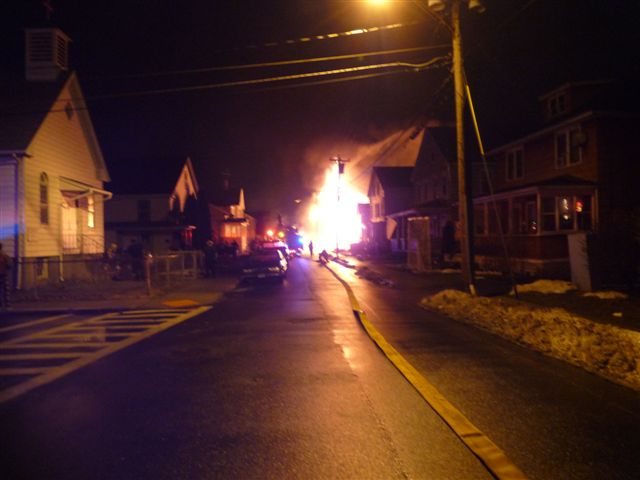 The fire can be seen down the street