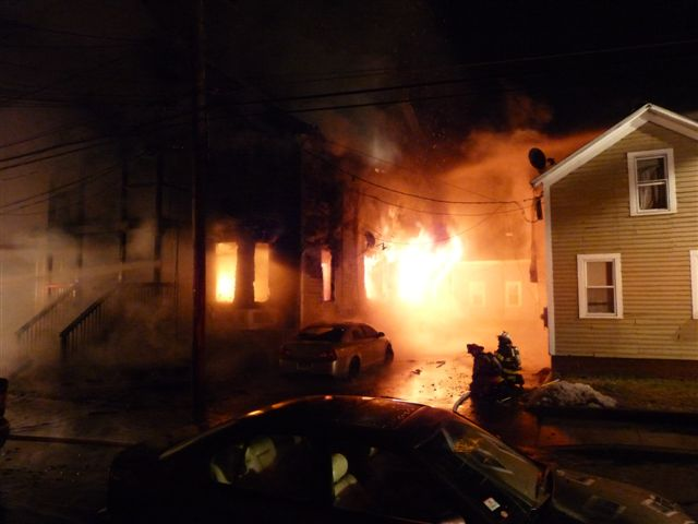 Fire burning through a home on Church Street