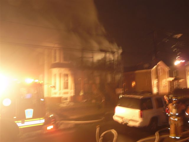 Smoke billows out of the 2nd story of the home
