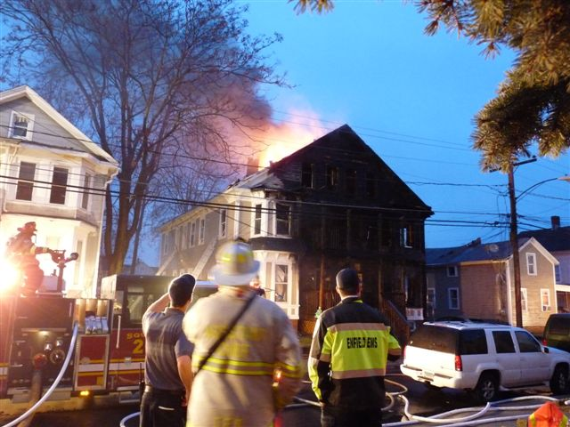 The fire is almost under control, flames still seen rising from the back