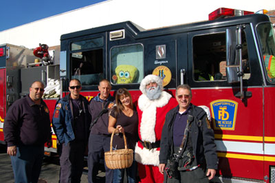 Firefighters get their picture with Santa